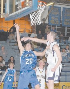 Letcher County Central's Jordon Reynolds put up a shot over a Hazard defender during the Cougars' game against the Bulldogs last week. No. 13 for Letcher Central is Josh Proffitt. (Photo by Chris Anderson)