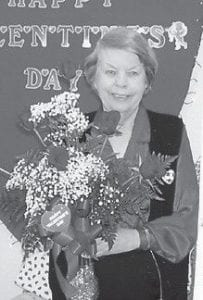 WINNER -  Kathy Palumbo won the door prize of red roses at a Valentine's Day party at the Ermine Senior Citizens Center.