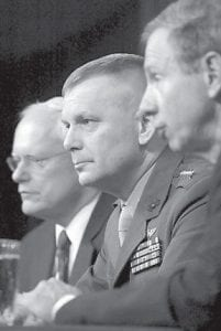 Joint Chiefs Vice Chairman Gen. James Cartwright, center, flanked by Deputy National Security Adviser James Jeffrey, left, and NASA Administrator Michael Griffin, took part in a recent news conference at the Pentagon to discuss the use of a Navy missile to attempt to destroy a broken U.S. spy satellite. (AP Photo/Heesoon Yim)