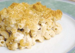 This recipe for a lighter macaroni and cheese dish is every bit as satisfying as the original. (AP photo)