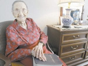 Rosa McGee, 104, was photographed while sitting inside her daughter's Chicago apartment with her Bible recently. A recent study has found that reaching the age of 100 has gotten easier. (AP Photo/M. Spencer Green)