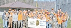 ANNUAL RABBIT HUNT -  At least sixty-four children, both boys and girls, braved the cold winter earlier this winter to hunt rabbits throughout Letcher and Knott counties. The annual Rabbit Hunt for Kids was sponsored by he Little Shepherd Chapter of the National Wild Turkey Federation and local wildlife conservation officials also held their annual Rabbit Hunt for Kids. After several hours in the field, they all joined together at the Shriners' building in Whitesburg. After eating, each group went to the county to shoot clay pigeons. Before leaving the park, door prizes including shotguns and fishing poles, were handed out. The event, held at the end of December in conjunction with the Kentucky Department of Fish and Wildlife's Youth Hunt, was free for any child between the ages of 6 and 17 who had signed up. The Chapter will be holding its annual banquet and membership drive on Saturday, March 1, at Letcher County Central High School. Any person interested in supporting local youth is invited to attend. Tickets may be obtained from John B. Adams Store at Isom or by contacting any member of the chapter.