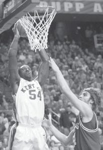Kentucky's Patrick Patterson (54) goes up for a dunk next to Arkansas' Steven Hill during Kentucky's 63-58 basketball game victory at Rupp Arena in Lexington, Ky., on Saturday, Feb. 23, 2008. Patterson had 14 points and 11 rebounds in the win. (AP Photo/ James Crisp)
