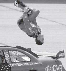 Carl Edwards did a back flip off of his car after winning a rain delayed NASCAR Sprint Cup Auto Club 500 at the Auto Club Speedway in Fontana, Calif., on Monday. (AP Photo)