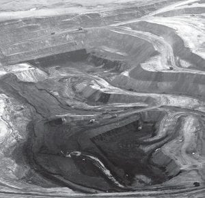 A large strip mine is seen from the air in northeast Wyoming near Gillette, Wyo. Facing a bruising fight over climate change, the coal industry is on the political offensive this election year to ensure that no matter who wins in November, so does coal. (AP Photo)