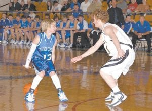 Letcher County Central's Josh Proffitt dribbled behind his back while facing off against a Cordia defender in the boys' 53rd District Championship game at Knott County Central. (Photo by Chris Anderson)