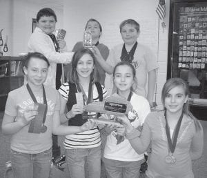 ACADEMIC TEAM -  The Fleming-Neon Elementary School academic team placed first in Quick Recall and second overall at the district tournament held March 1. The team also received the Catherine Hume Sportsmanship Award. Individual awards were: Linsey Bentley, first place English composition and fifth place math; Makaley Johnson, fifth place English composition; Cameron Wright, first place social studies and first place language arts; Cody Hampton, fourth place social studies and third place language arts; Caitlyn Esteves, fourth place arts and humanities; and Danielle Sturgill, fifth place arts and humanities. Pictured are (front row, left to right) Caitlyn Esteves, Makaley Johnson, Linsey Bentley, Danielle Sturgill, (second row) Cody Hampton, Stamper Collins, and Cameron Wright. Not pictured is Dalton Meade.
