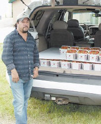 Antonio Granados, above, has spent the last week driving two hours every day to Ermine from Rogersville, Tenn., to sell strawberries