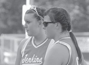 Jenkins infielders Brooke Webb, left, and Whitney Gibson looked on in frustration between innings of their team's loss in the 14th Region title game. (Photo by Chris Anderson)