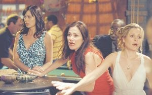 Catherine Bell, Kim Delaney and Sally Pressman are shown in a scene from