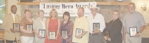 The Letcher County Chamber of Commerce recently honored nine community residents for their continuing work as volunteers. Pictured from left are Bishop Willie Lamb, Geraldine McDonald, Shirley Breeding, Sarah Tackett Brown, Joanna Gerhardt, Jimmy Polly, Stanley Gibson, Alberta Perry and Ted Adams.