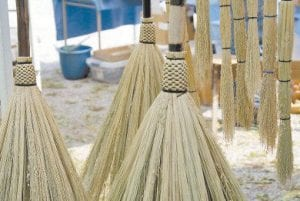 The brooms were among the handcrafted items for sale.