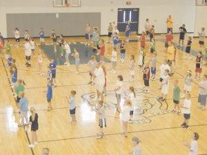 Former University of Kentucky basketball player Jeff Sheppard instructed children during a