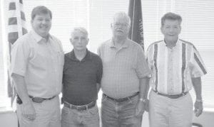 Letcher County Judge/Executive Jim Ward, left, poses with Buddy Sexton, Truman Halcomb and Delbert Anderson, the three men who will compose the Letcher Fiscal Court's new committee on blighted and deteriorated property.