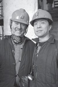 Ted Koppel poses with a coal miner in Datong, in the Chongqing province of China, for a four-part series examining contemporary China called,