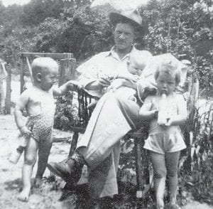 ADAMS FAMILY -  Marlowe resident Earl Adams is pictured with his three children. This photograph comes from Jim Cornett.