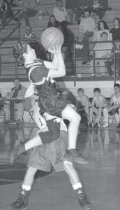 This February 2007 photo provided by the Maddox family shows McCall Maddox (6) playing basketball in Jacksboro, Texas. Injuries once seen mostly in adult athletes are now becoming distressingly common in children -  and not just high-school athletes, but elementary school kilds.