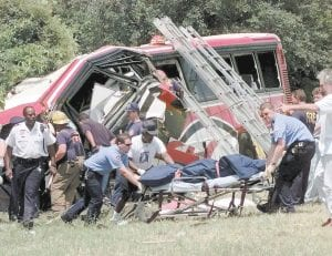 In this May 9, 1999 file photo, emergency workers remove the body of one of the victims of a bus wreck in New Orleans. A chartered bus carrying members of a casino club on a Mother's Day gambling excursion crashed killing 22 people. The National transportation Safety Board said the bus driver suffered life-threatening kidney and heart conditions but held a valid license and medical certificate. Moments before the crash, a passenger recounted seeing the driver slumped in his seat (AP Photo)