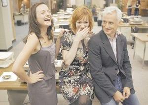 Actors Elisabeth Moss, left, Christina Hendricks and John Slattery are seen at the set of