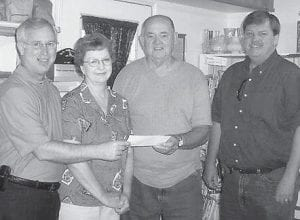 DONATION — Maurice Royster, manager of Equitable Resources, presents a $1,000 check to Ray Bird, the co-chair of Eolia Community Park Committee, for the benefit of the park. Pictured are (left to right) Maurice Royster, Brenda Gross, Ray Bird, and Letcher County Judge/Executive Jim Ward.