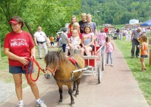 Kentucky First Lady Jane Beshear rode in a pony cart with some of the children who attended the event.