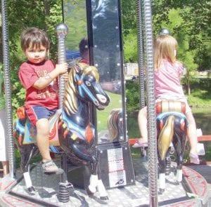 Joseph Alpizar, 3, held on tight as he rode a carousel.