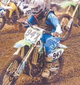 Motocross racer Donnie Adams of Letcher County is seen in photo at right and on his racing bike above.