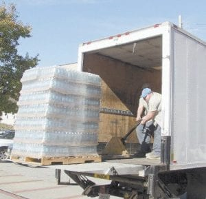 City of Whitesburg employee Ken Sexton Jr. unloaded pallets of drinking water supplied by Childers Oil Company.
