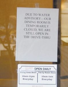 THE SIGN SAYS — This sign on the door of Wendy's restaurant in West Whitesburg sums up the problems being encountered by many businesses in the city this week. It was not known at presstime when the water might be declared safe.