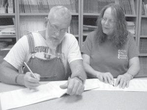 LEARNING TO READ — Alan Adams grabs his second chance to learn to read while working with Letcher County Adult Education instructor Brenda Caudill.