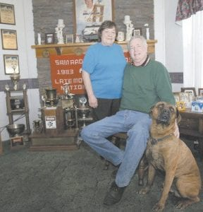 Sam Ard and his wife Jo posed for a family photo with their dog