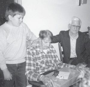 NURSING HOME VISIT — Preacher Bill Howard (right) and his grandson, Chad Brown (left), who is a father himself now, visited with a resident of Golden Years Rest Home with their church some years ago.