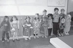 IN COSTUME — (Left to right) Kaitlyn Dickerson, Callie (granddaughter of Rev. Ron and Mitzie Oplinger), Kenan Broersma, Lydia Broersma, Caleb Broersma, Leah Bouldon, Isaac Bouldon, Prince Miranda, and Princess Miranda dressed in costumes for Kids' Time at ECCO on October 31.