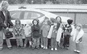 FIELD TRIP — Cowan Head Start had an educational field trip to the sheriff's office on Oct. 28 and 29. Twenty-one children attended, accompanied by staff and parents Kathy Trent, Dinah Fields, and Mary Coyle. The children enjoyed touring the sheriff's office and of course the main attraction, the patrol cars. Seventy members of the family of Phoebe Fields gathered at the Cowan Community Center to celebrate her 90th birthday.
