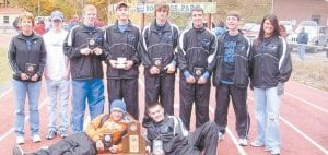 Members of the LCC boys' cross-country team are (left to right) Coach Sally Hubbard, Byron Sandlick, Trenton Whitaker, Corey Stagner, James 'Goose' Gose, Jake Dixon, Eric Fields, Cassie Whitaker, (front row) Dakota 'DK' Kincer, and Tyler Smith. Not pictured: Cody Gregory.