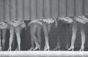 The Radio City Rockettes walked offstage in Cincinnati as they took a break from rehearsal for the Radio City Christmas Spectacular. (AP Photo)