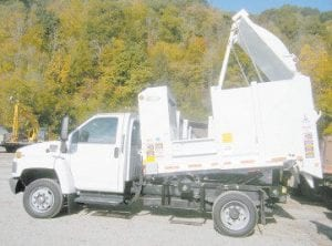 Letcher Judge/Executive Jim Ward said costs are down in the Letcher County Sanitation Department and will go down even more when a new haul schedule is implemented in January to take advantage of the greater mobility and lower fuel costs of the new mini-packer trucks like the one shown here.