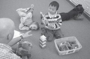 Teacher Matt Bugaj uses Twiggle the Turtle hand puppet to teach the