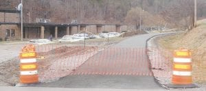 MOTOR VEHICLES NOT ALLOWED — Barriers have been put in place while officials are trying to determine how to keep vehicles off this walking and bicycle path in West Whitesburg.