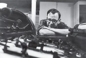 Publisher Tom Gish watched as pages of The Mountain Eagle were printed on a small sheet-fed offset press in the mid-1960's. Gish died November 21, nearly 52 years after he and his wife, Pat, assumed ownership of the paper. (Photo by Tom Bethell)