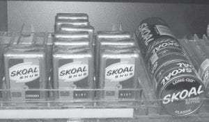 Skoal Snus product is racked alongside traditional spit tobacco behind a store counter in Morgantown, W.Va. (AP photo)
