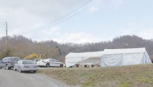 ROADSIDE DRUGS? — Letcher County sheriff's deputies and Kentucky State Police converged on a fruit and vegetable stand in West Whitesburg on Tuesday. Sheriff Danny Webb said drugs being sold at the stand were being supplied by a used car salesman working nearby. (Eagle photo)