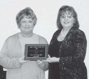 CENTER OF THE YEAR — The Ermine Senior Citizens Center recently was named the Senior Center of the Year. Site manager Debbie Slone accepted the award from Peggy Roe of the Kentucky River Area Development District.