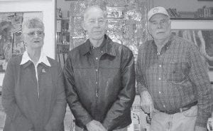 ART EXHIBIT — Doug Adams (at right) is pictured with brother-inlaw Nathan Baker and Doris Adams. Doris Adams and Nathan Baker are member of the Letcher County Tourism Commission, which is sponsoring an art exhibit in which Doug Adams is participating.