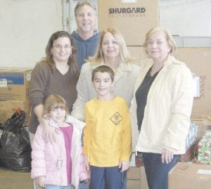 EMERGENCY AID FOR CHILDREN will deliver Christmas gifts to 25 Letcher County families this week. Pictured are Rachel and Kyle Hendrian, mother Dianne Hendrian,grandparents Mary and Jim Hendrian, and grandmother Liz Oliveri.