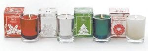 This photo provided by Slatkin & Co. shows scented candles in Spice, Winter, Tree and Frosted Cranberry. Home-fragrance guru Harry Slatkin uses scented candles or plug-ins he sells at Bath & Body Works to most often mimic the real thing, but he's been known to boil apples on top of the stove too. (AP Photo)