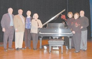 Members of the Whitesburg High School Alumni Committee posed for a photograph standing beside the new Steinway