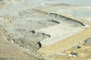 In this image provided by Greenpeace, coal ash slurry left behind in a containment pond near the Tennessee Valley Authority's Kingston Fossil Plant is shown this week in Harriman, Tenn., after the dyke at left broke Dec. 22, unleashing a billion gallon flood of toxic sludge into the Emory River. (AP Photo/Greenpeace, Wade Payne)