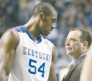 Kentucky coach Billy Gillispie had a word for Patrick Patterson (54) after pulling him in the second half of UK's NCAA college basketball game against Central Michigan in Lexington on Monday. Patterson had 15 points and nine rebounds in the 84-52 Kentucky win. (AP Photo/Ed Reinke)