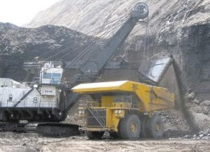 A shovel prepared to dump a load of coal into a 320-ton truck at the Black Thunder Mine in Wright, Wyo. (AP)